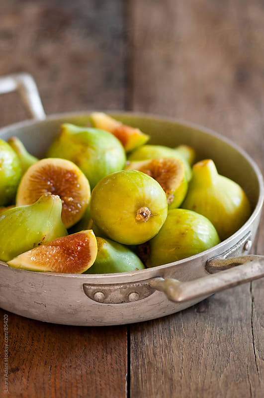 figs in an old pan by Laura Adani for Stocksy United