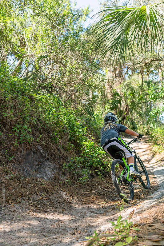 Woman Ripping up Florida Mountain Bike Trails by suzanne clements for Stocksy United