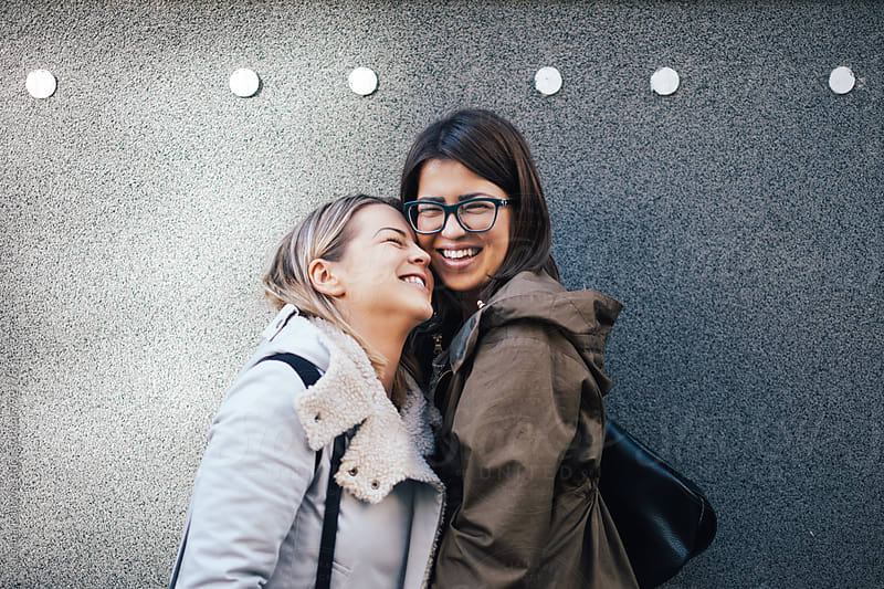 Two Female Friends Smiling by Katarina Radovic for Stocksy United