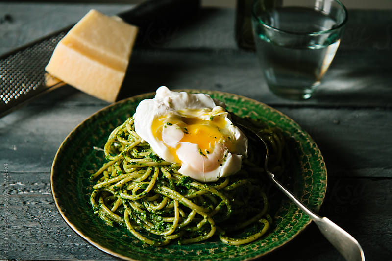 Watercress pesto spaghetti with a poached egg by Helen Rushbrook for Stocksy United