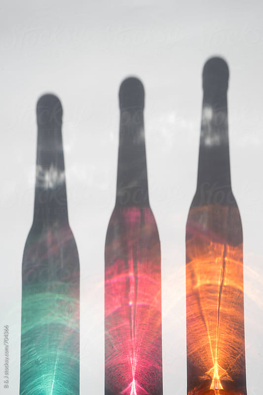 Colorful bottles reflection. by B & J for Stocksy United