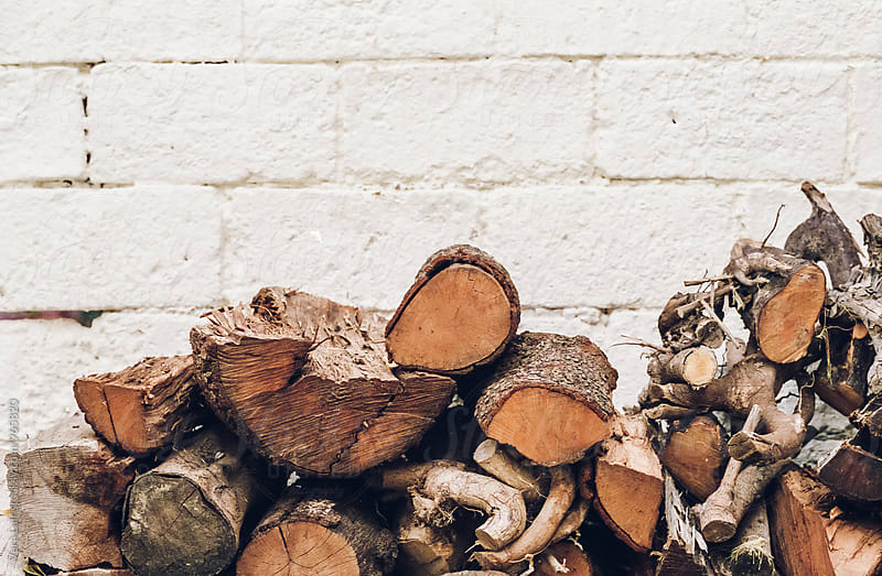 Firewood pile by Vera Lair for Stocksy United