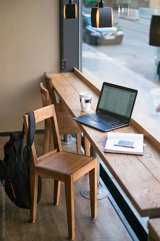Working on a laptop at the caffee. by Jelena Jojic Tomic for Stocksy United