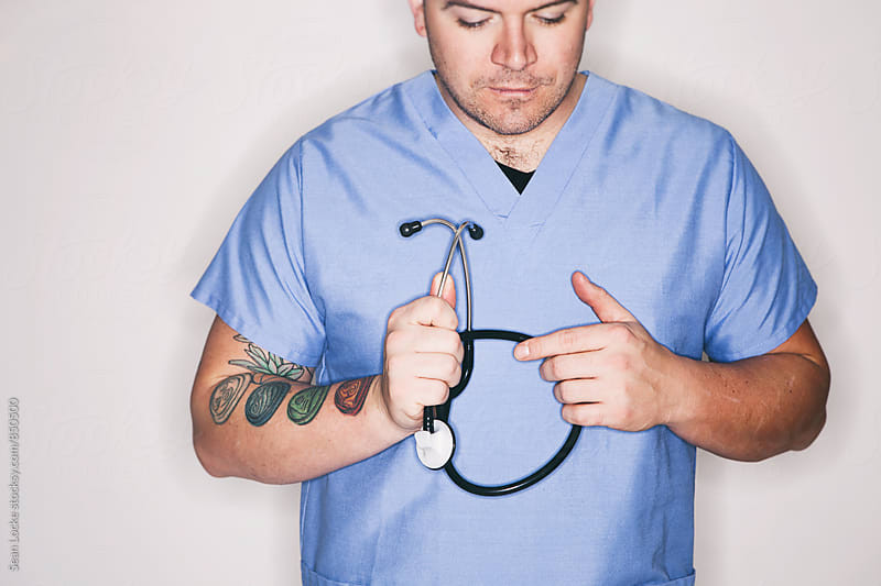 Medical: Doctor Holds Stethoscope With Both Hands by Sean Locke for Stocksy United