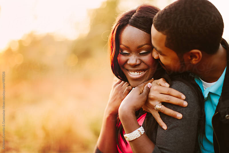 Affectionate and happy black couple together outdoors by Kristen Curette Hines for Stocksy United
