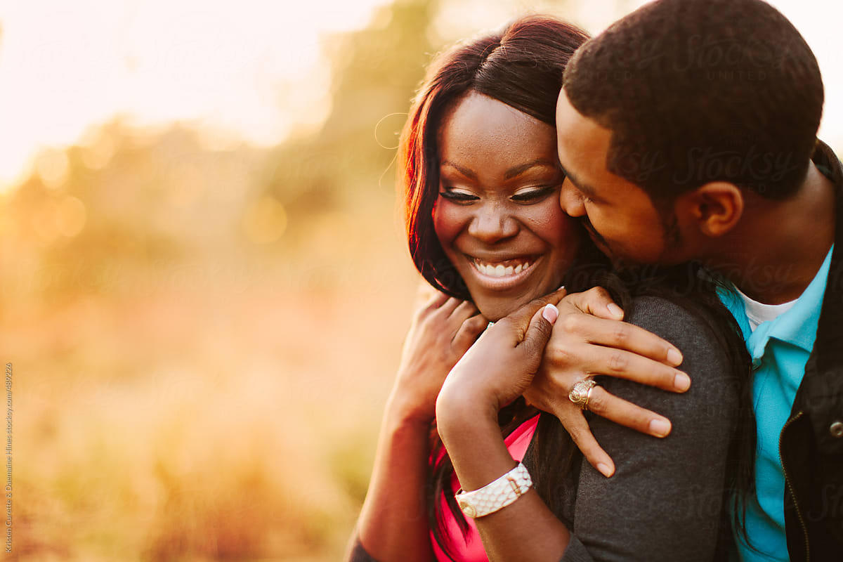 Affectionate And Happy Black Couple Together Outdoors by Kristen Curette &  Daemaine Hines