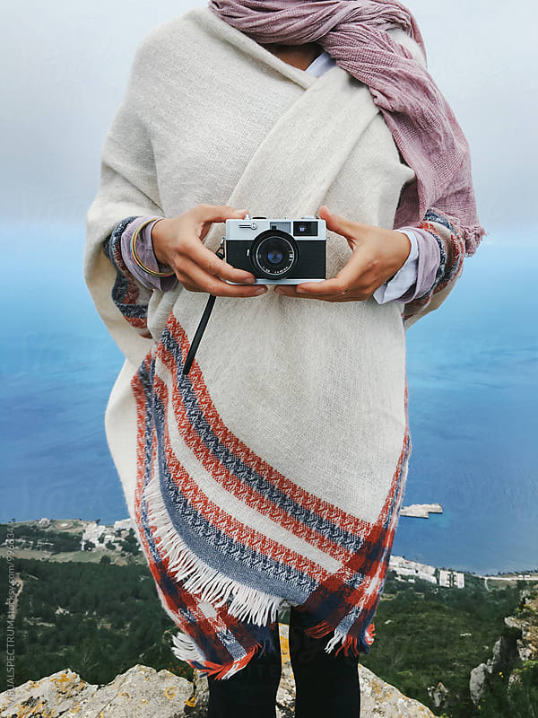 Woman in Cute White Poncho Holding Old-Fashioned Rangefinder Camera by VISUALSPECTRUM for Stocksy United