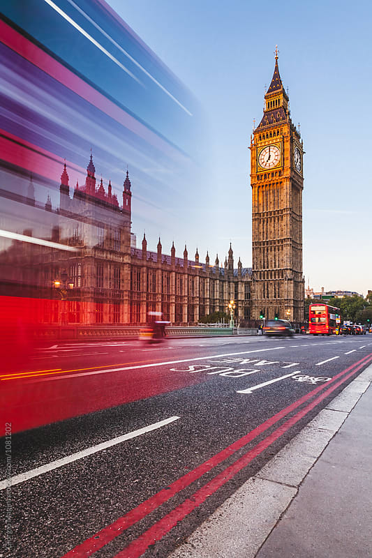 Fast Double Decker Bus in front of the Big Ben, London by Giorgio Magini for Stocksy United