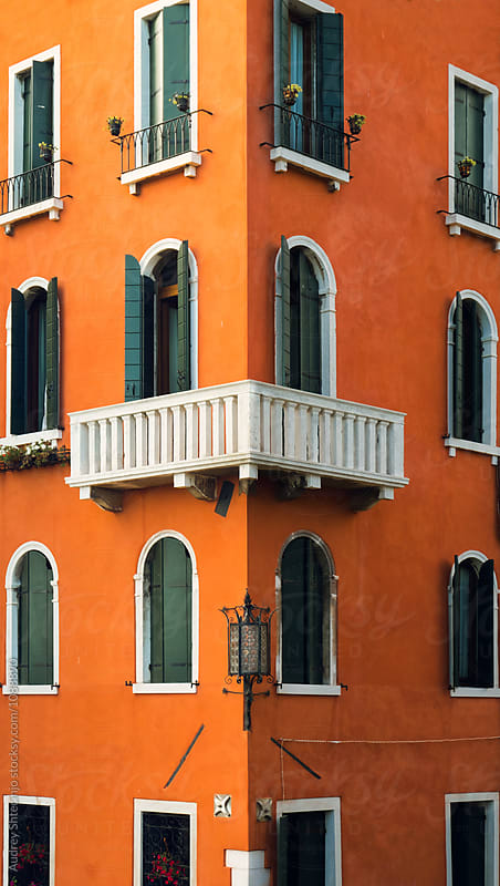 Antique building facade corner with windows and balconies.Venice/Italy by Marko Milanovic for Stocksy United