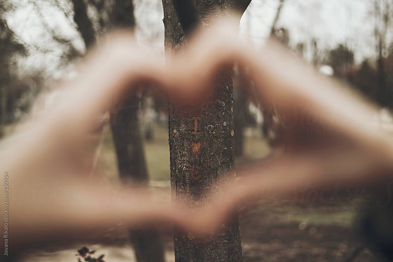 Man making a heart sign with his hands by Jovana Rikalo for Stocksy United