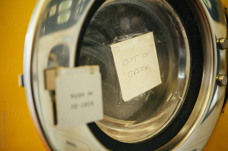 Out of order sign on a washing machine. by kkgas for Stocksy United