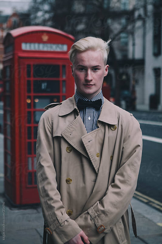 Fashionable young man in front of phone box in Soho London. by kkgas for Stocksy United