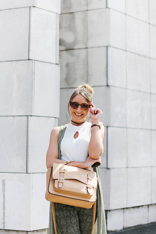 Blonde woman smiling  by Marija Kovac for Stocksy United