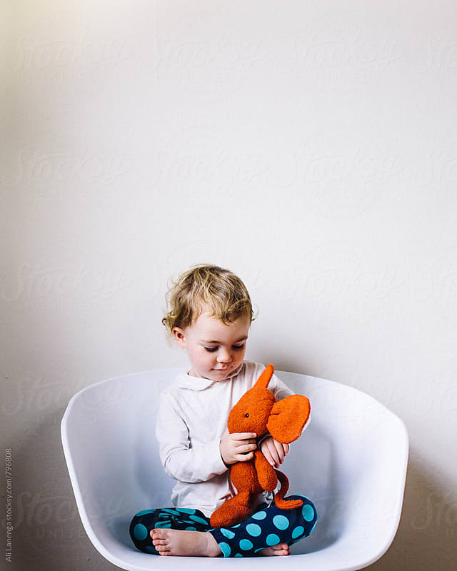 Girl in a chair by Ali Lanenga for Stocksy United