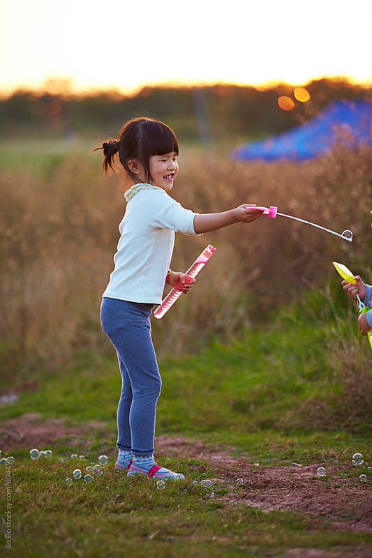 one happy asian little girl outdoor by Bo Bo for Stocksy United