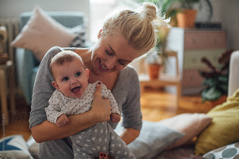 Mother Holding Baby Girl by Lumina for Stocksy United