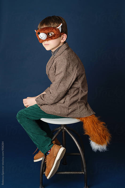 Boy dressed as a fox by Rebecca Spencer for Stocksy United