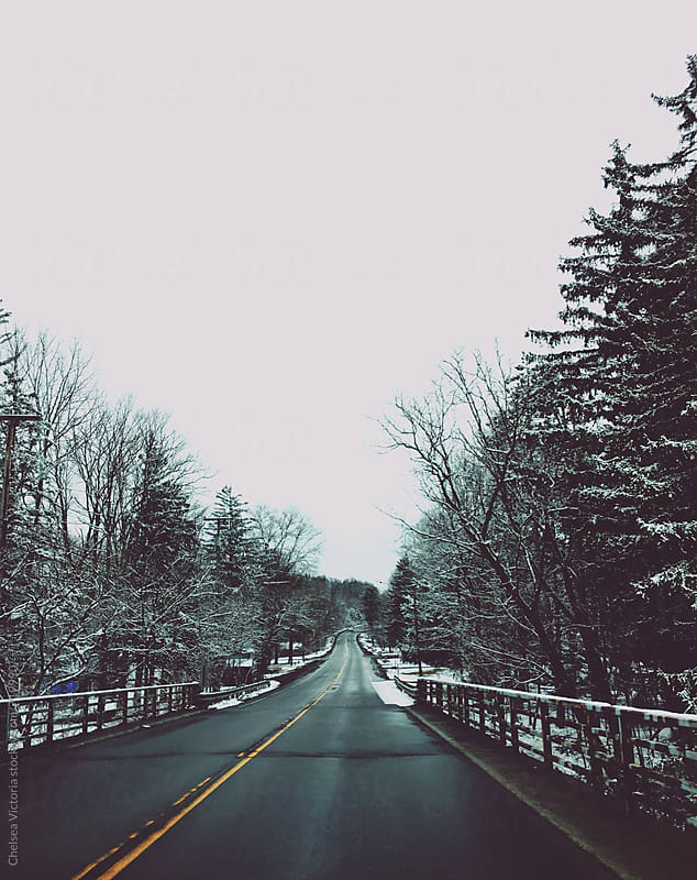 A snowy road by Chelsea Victoria for Stocksy United