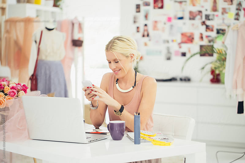 Businesswoman Sending a Text Message by Lumina for Stocksy United