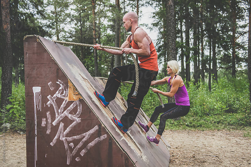 workout at obstacle course by Andreas Gradin for Stocksy United