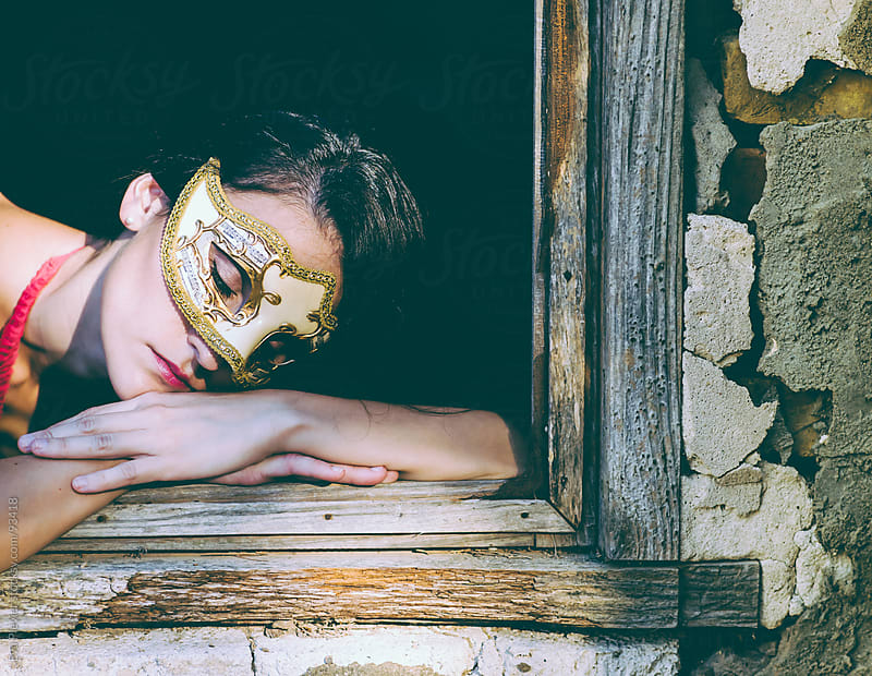 Young woman resting by the window. by Eva Plevier for Stocksy United