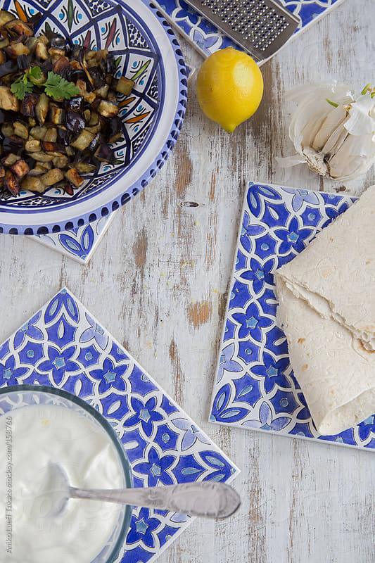 Eastern style aubergine and yogurt on white board by Aniko Lueff Takacs for Stocksy United
