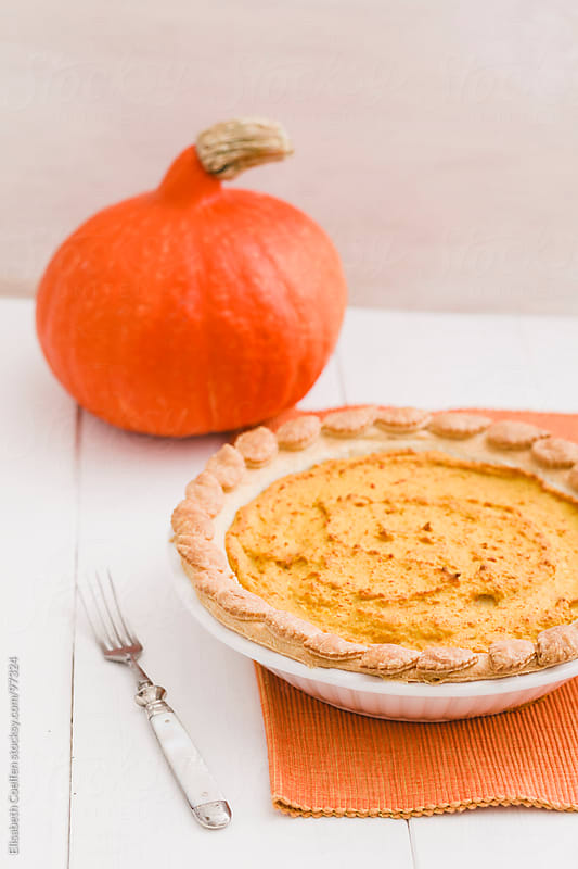 Pumpkin pie, pie crust decorated with leaves by Elisabeth Coelfen for Stocksy United