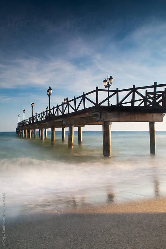 Pier in Marbella beach by ACALU Studio for Stocksy United