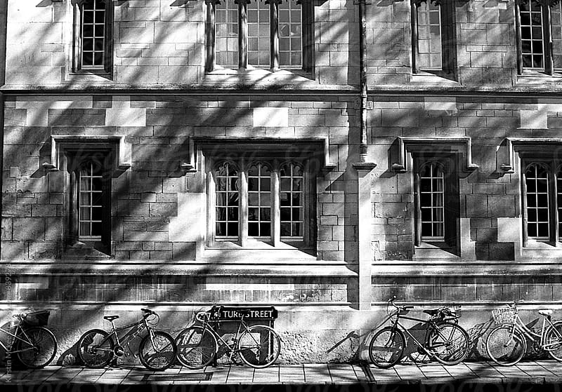 Street with bicycles in Oxford by Kirstin Mckee for Stocksy United
