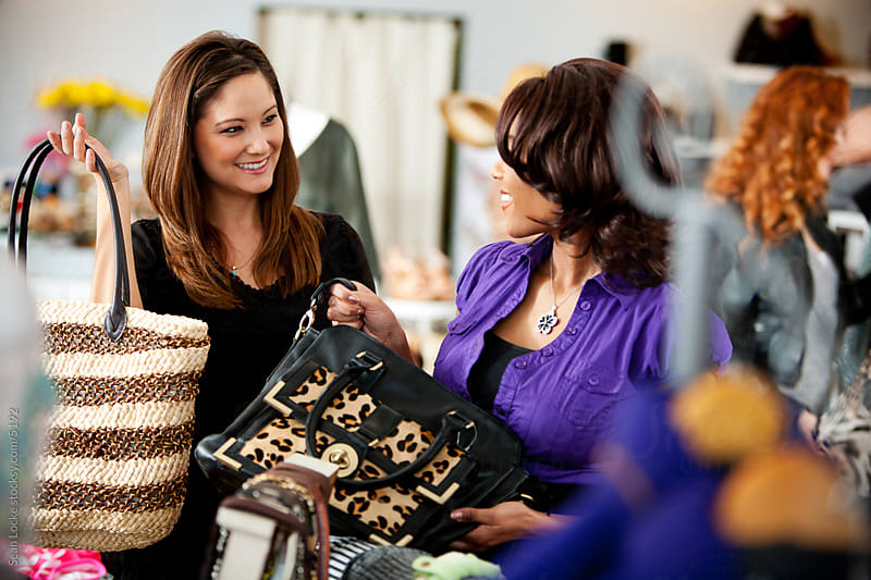 Boutique:Two Women Browsing Purses While Shopping by Sean Locke for Stocksy United