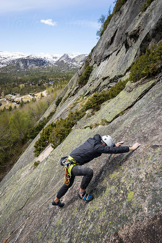 Climbing sport route in setesdal, Norway by Tristan Kwant for Stocksy United