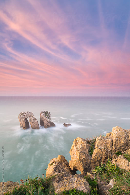 Beautiful and colorful sunset from a cliff by Marilar Irastorza for Stocksy United