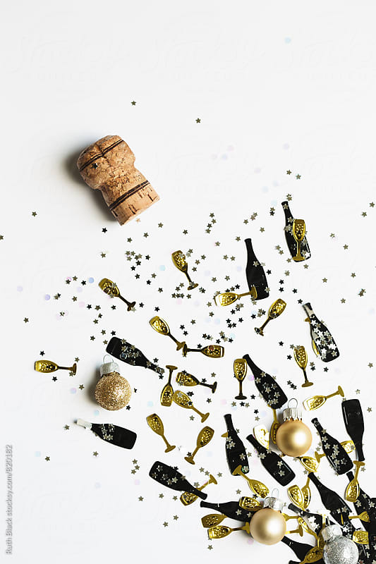Popping champagne cork and confetti by Ruth Black for Stocksy United