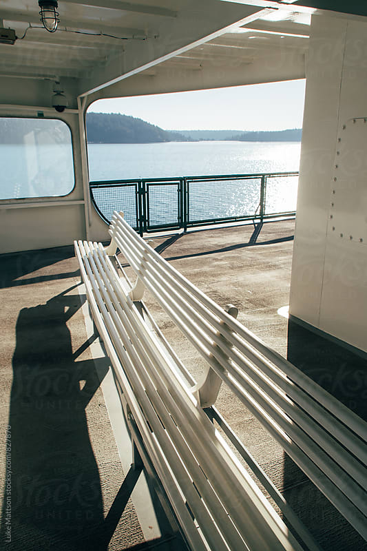 Empty White Bench On Upper Deck Of Passenger Ferry Boat by Luke Mattson for Stocksy United