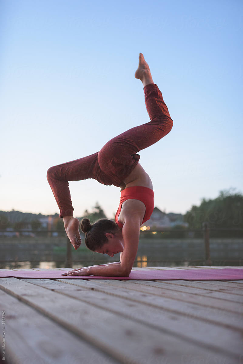 Woman Doing Advanced Yoga Pose Outdoor By The River By Ibex Media Full Length Yogi Stocksy United