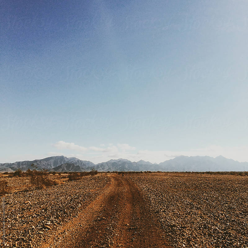Dirt Road to Mountains by Ben Sasso for Stocksy United