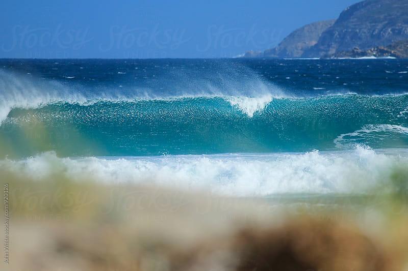 Wave breaking.  by John White for Stocksy United
