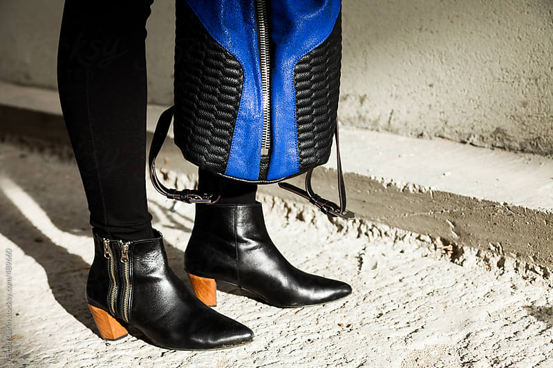 Stylish Leather & Backpack Boots on Concrete by Eldad Carin for Stocksy United