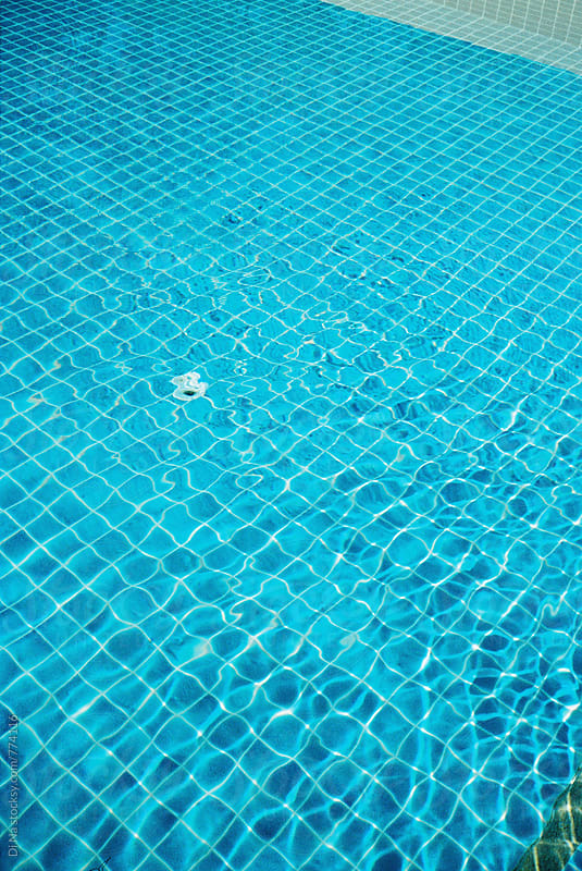 Swimming pool  by Dina Lun for Stocksy United