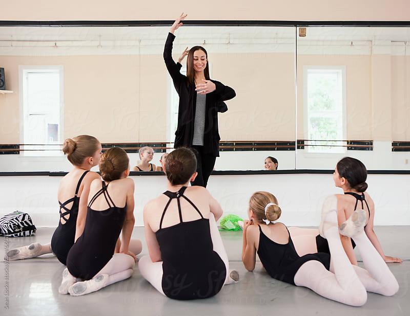 Ballet: Teacher Shows Proper Form by Sean Locke for Stocksy United