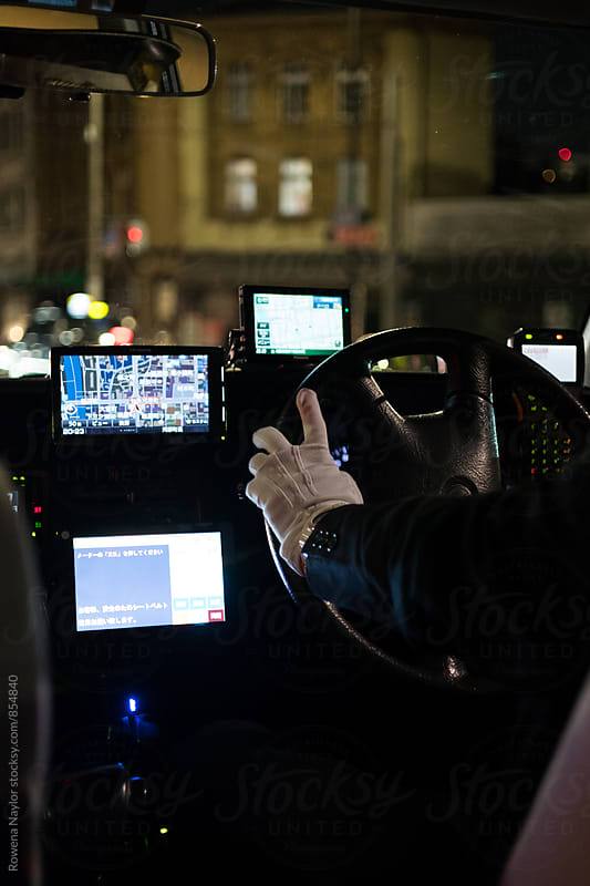 View from the passenger seat of a taxi cab in Japan by Rowena Naylor for Stocksy United
