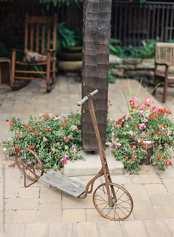 Vintage scooter at wood cabin by Vicki Grafton Photography for Stocksy United