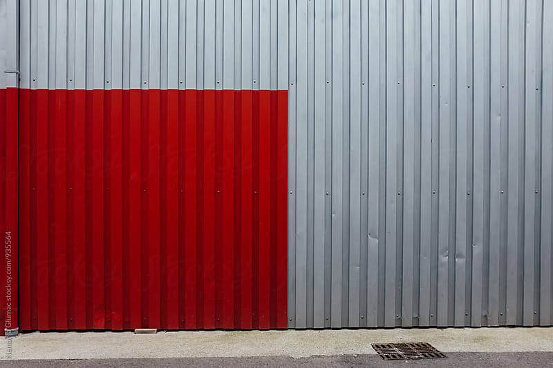 Red Square Painted on Corrugated Metal Wall by Nemanja Glumac for Stocksy United