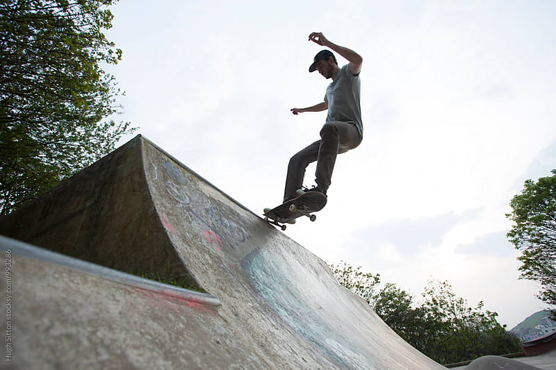 Skateboarder practising his skills.  by Hugh Sitton for Stocksy United