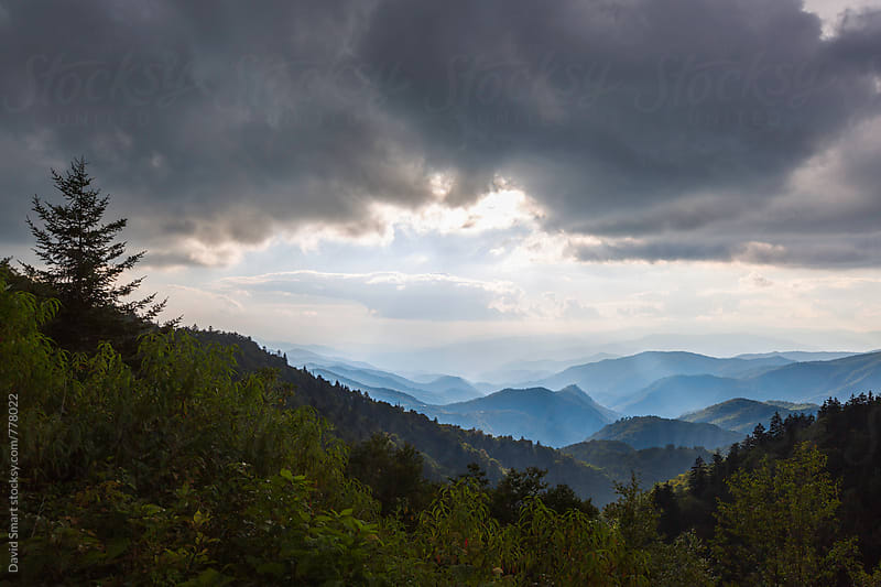 Storm clouds and sun over Blue Ridge Mountains by David Smart for Stocksy United