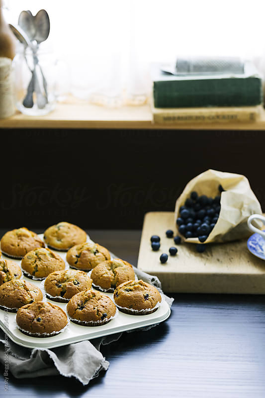 Tray of a dozen blueberry muffins by Kirsty Begg for Stocksy United