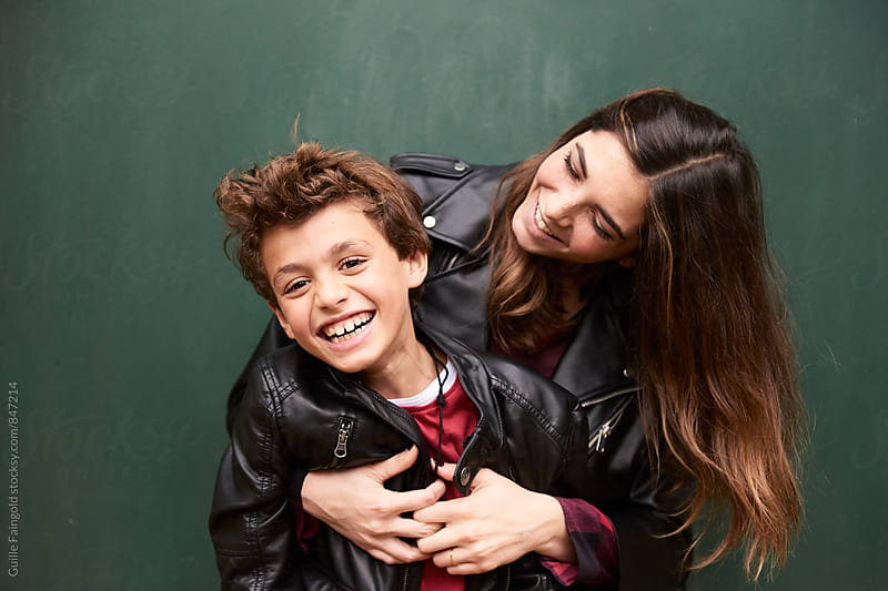 Portrait of mother and child laughing by Guille Faingold for Stocksy United