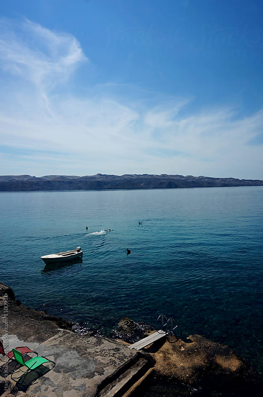 Photo of a sea and boat from my travel diary by Hamza Kulenović for Stocksy United