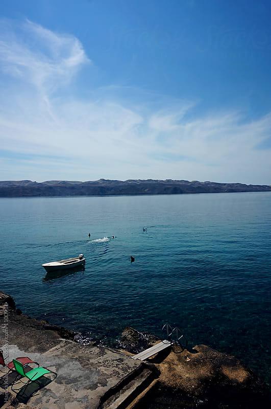 Photo of a sea and boat from my travel diary by Hamza Kulenović for Stocksy United