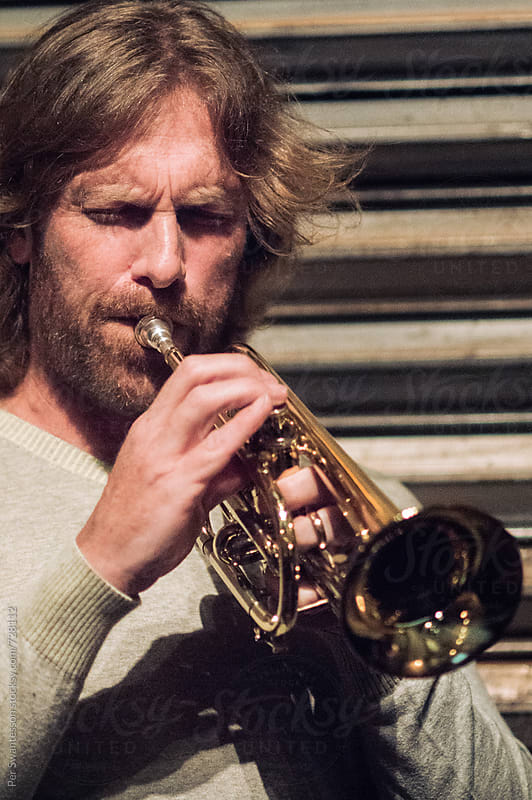 Portrait of professional musician playing the trumpet by Per Swantesson for Stocksy United
